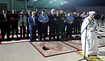Palestinian Prime Minister Rami Hamdallah performs prayer after breakfasting with security forces on the Muslim holy fasting month of Ramadan, in the West Bank city of Jenin on June 18, 2017. Photo by Prime Minister Office