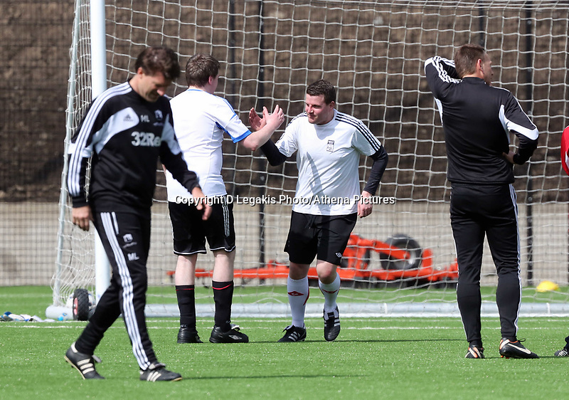 Thursday 11 April 2013<br /> Pictured: South Wales Evening Post sports reporter Gareth Vincent (3rd L) celebrating scoring from the penalty spot with team mate. <br /> Re: Friendly game, Swansea City FC coaching staff v sports reporters at the Swansea City FC training ground. Final score 10-4.