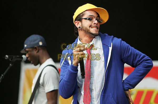 GYM CLASS HEROES.Performing live on stage at The 10th Annual KIIS FM Wango Tango 2007 held at Verizon Wireless Ampitheatre in Irvine, California, USA, May 12 2007..full length concert music gig shorts blue cardigan yellow cap hat red tie white shirt funny glasses beard nose ring funny face mouth.CAP/DVS.©Debbie VanStory/Capital Pictures