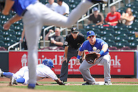 First baseman Allan Dykstra #10 of the Las Vegas 51s gathers in pickoff throw from pitcher against the Omaha Storm Chasers at Werner Park on August 17, 2014 in Omaha, Nebraska. The Storm Chasers  won 4-0.   (Dennis Hubbard/Four Seam Images)