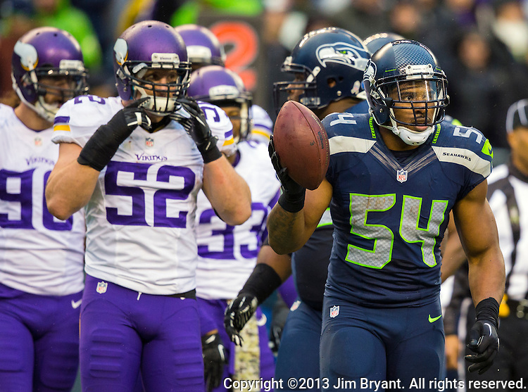 Seattle Seahawks  linebacker Bobby Wagner (54) celebrates a pass interception against the Minnesota Vikings  at CenturyLink Field in Seattle, Washington on  November 17, 2013.  The Seahawks beat the Vikings 41-20.  ©2013.  Jim Bryant. All Rights Reserved.