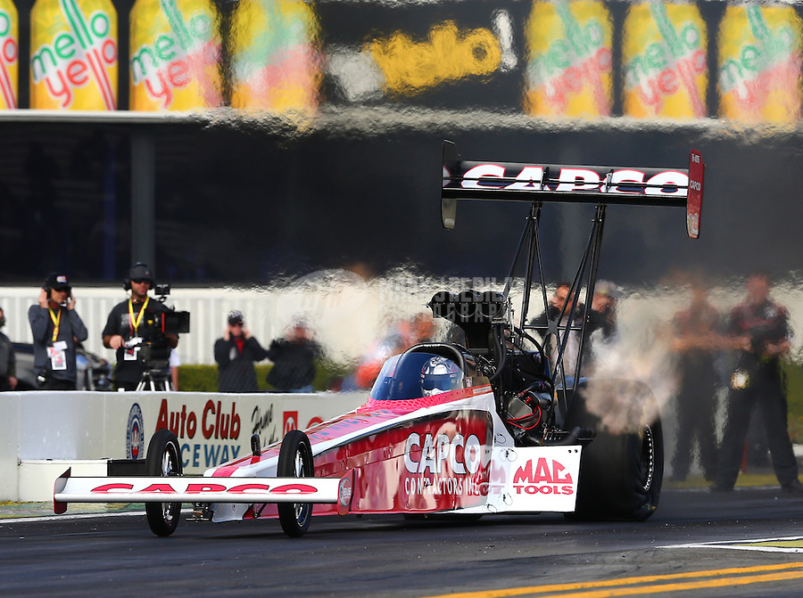 Feb 7, 2014; Pomona, CA, USA; NHRA top fuel dragster driver Steve Torrence during qualifying for the Winternationals at Auto Club Raceway at Pomona. Mandatory Credit: Mark J. Rebilas-