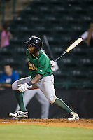 John Mora (4) of the Savannah Sand Gnats follows through on his swing against the Hickory Crawdads at L.P. Frans Stadium on June 15, 2015 in Hickory, North Carolina.  The Crawdads defeated the Sand Gnats 4-1.  (Brian Westerholt/Four Seam Images)