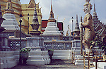 "The Wat Phra Kaew is regarded as the most sacred Buddhist temple in Thailand. It is a ""potent religio-political symbol and the palladium of Thai society"". It is located in Phra Nakhon District, the historic centre of Bangkok, within the precincts of the Grand Palace."