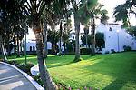 Cutting the grass in a hotel resort. Calleta del Fuste, Fuerteventura, Canary Islands, Spain