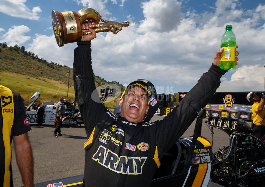 Jul 24, 2016; Morrison, CO, USA; NHRA top fuel driver Tony Schumacher celebrates after winning the Mile High Nationals at Bandimere Speedway. Mandatory Credit: Mark J. Rebilas-USA TODAY Sports