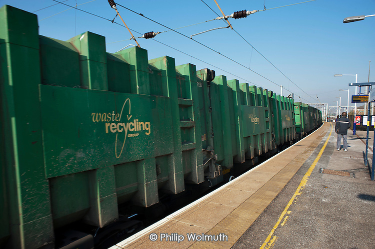 A Waste Recycling Group freight train passes through Cricklewood station.
