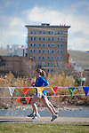 Two runners approach the finish line of the Riverbank Run in Missoula, Montana