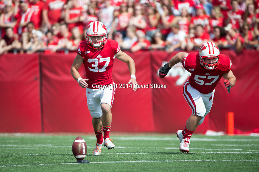 Wisconsin Badgers kicker Andrew Endicott (37) kicks the ball during an NCAA college football game against the South Florida Bulls Saturday, September 27, 2014, in Madison, Wis. The Badgers won 27-10. (Photo by David Stluka)
