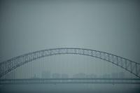 Daytime Landscape View Of The Chaotianmen Changjiang Bridge Over The Yangtze River In Chongqing, China.  © LAN
