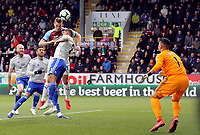 Burnley's Chris Wood with an early headed effort on goal despite the attentions of Cardiff City's Lee Peltier<br /> <br /> Photographer Rich Linley/CameraSport<br /> <br /> The Premier League - Saturday 13th April 2019 - Burnley v Cardiff City - Turf Moor - Burnley<br /> <br /> World Copyright © 2019 CameraSport. All rights reserved. 43 Linden Ave. Countesthorpe. Leicester. England. LE8 5PG - Tel: +44 (0) 116 277 4147 - admin@camerasport.com - www.camerasport.com