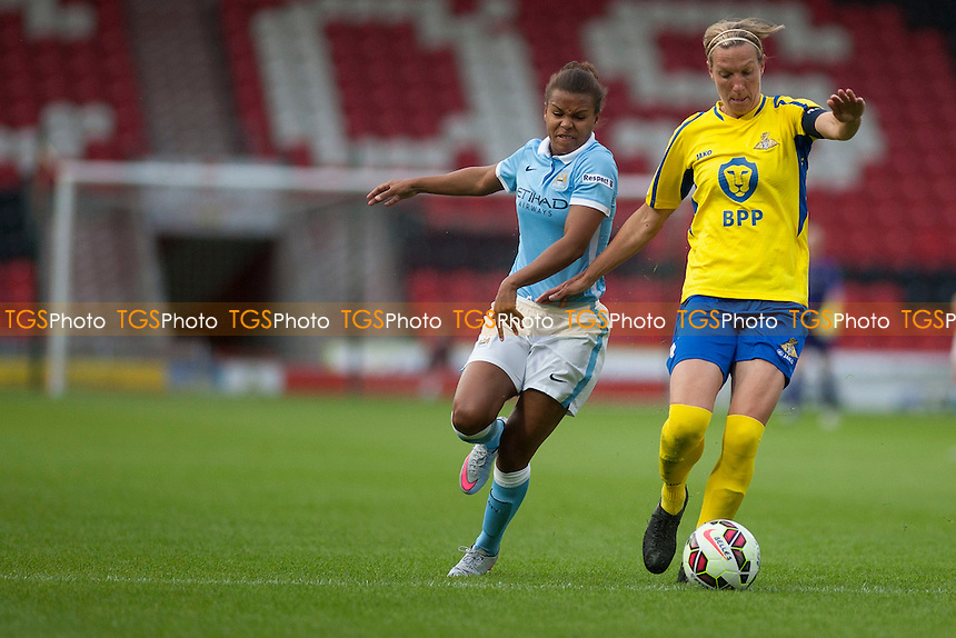 Nikita Parris (Man City Women) and Leandra Little (Doncaster Belles)<br /> Doncaster Rovers Belles vs Manchester City Women, FA Womens Super League Continental Tyres Cup Football at the Keepmoat Stadium, Stadium Way, Doncaster, West Riding of Yorkshire on 23/07/2015 - MANDATORY CREDIT: Mark Hodsman/TGSPHOTO