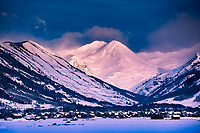 The days first light illuminates the mountains above the town of Crested Butte, Colorado.