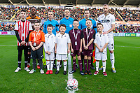 Mike van der Hoorn of Swansea City with mascots during the FA Cup Fifth Round match between Swansea City and Brentford at the Liberty Stadium in Swansea, Wales, UK. Sunday 17 February 2019
