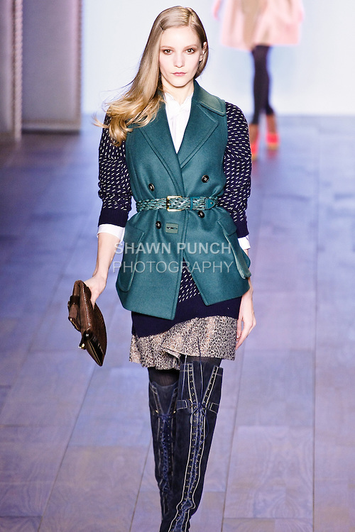Dorothea Barth Jorgensen walks Tommy Hilfiger Fall 2010 Preppy With A Pop runway show in a bettle green pressed wool peacoat, Navy Birdseye sweater, white silk broadcloth shirt, and Khaki jacquard skirt, during the Mercedez-Benz Fashion Week.
