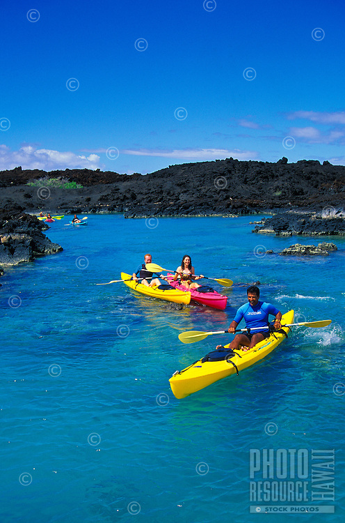 Kayakers in La Perouse Bay on Maui's south side near the Ahihi Marine Preserve and below Makena, the site of the last lava flow on Maui