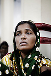 A refugee woman from Kandmahal district during the prayer at Peyton sahi relief comittee in Orissa's capital Bhubaneswar. Nov. 03, 2008.