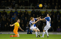 Ollie Clarke of Bristol Rovers & Rory Gaffney of Bristol Rovers go for the same ball as Danny Rowe of Wycombe Wanderers looks on during the Sky Bet League 2 rearranged match between Bristol Rovers and Wycombe Wanderers at the Memorial Stadium, Bristol, England on 1 December 2015. Photo by Andy Rowland.