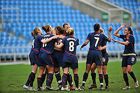 Carli Lloyd is congratulated by the team after scoring a goal. The USA captured the 2010 Algarve Cup title by defeating Germany 3-2, at Estadio Algarve on March 3, 2010.