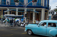 A group tour of photography tourists snap photos of Habana Vieja, Havana, Cuba