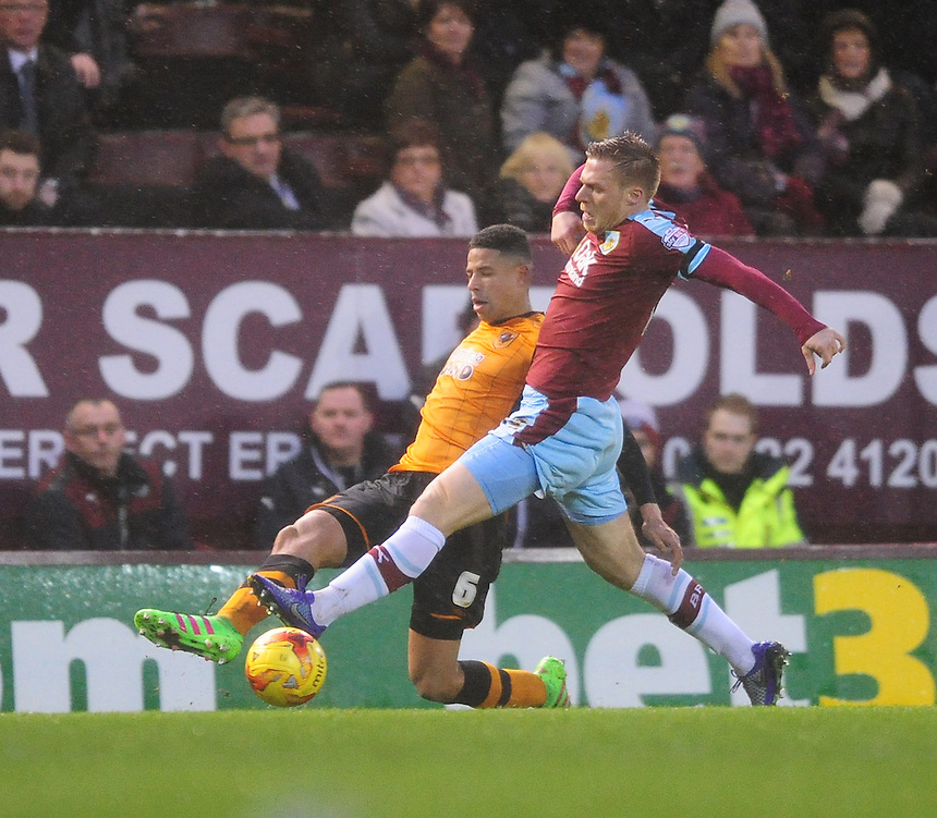 Hull City's Curtis Davies under pressure from Burnley&rsquo;s Rouwen Hennings<br /> <br /> Photographer Chris Vaughan/CameraSport<br /> <br /> Football - The Football League Sky Bet Championship - Burnley v Hull City - Saturday 6th February 2016 - Turf Moor - Burnley <br /> <br /> &copy; CameraSport - 43 Linden Ave. Countesthorpe. Leicester. England. LE8 5PG - Tel: +44 (0) 116 277 4147 - admin@camerasport.com - www.camerasport.com