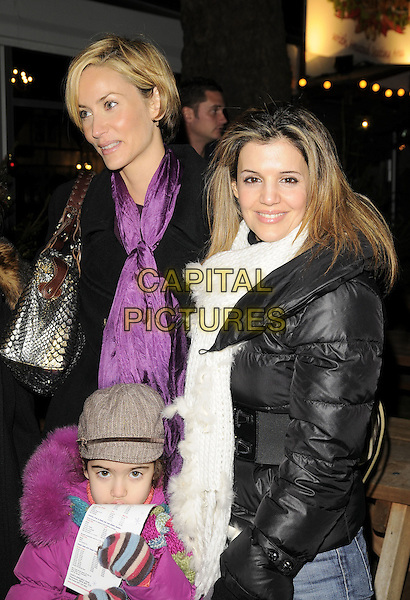 LISA BUTCHER, LINDA PAPADOPOULOS & KIDS.The Winter Wonderland launch party, Hyde Park, London, England..Novmber 20th, 2008.half length children jeans denim black pink coat jacket white scarf .CAP/CAN.©Can Nguyen/Capital Pictures.