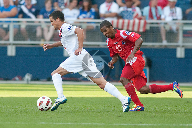 14 June 2011                        Canada midfielder Josh Simpson (11, left) is pressured by Panama defender Luis Henríquez (17) in the first half.  The Panama Men's National Soccer Team played against the Canada Men's National Soccer Team in the first qualifying round of the CONCACAF Gold Cup game at Livestrong Sporting Park in Kansas City, KS on June 14, 2011.