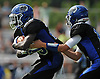 Nathaniel Larkins #23 of Glenn, left, takes a handoff from quarterback Kyle Tiernan #12 during the first quarter of a Suffolk County Division IV varsity football game against Mount Sinai at Glenn High School on Saturday, Sept. 10, 2016.