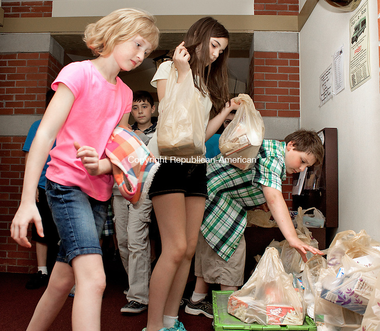 THOMASTON, CT- JUNE 06  2011-060612DA04-  Fifth-grade students of Thomaston Center School, from right, Hannah Stoveken, Haille Cash, and Jacob Hubbard carry groceries that the students and other classmates ordered through Peapod. The students used math and nutrition lessons to put together a complete Peapod order that they deliver in person to the Thomaston food bank. Peapod is the country's leading online grocer, and Thomaston Food Pantry challenged the classroom to utilize a donation from Peapod to create a delivery order of the most nutritious foods possible. .Darlene Douty Republican American