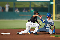 Amado Nunez (18) of the Kannapolis Intimidators reaches for a wide throw as Jeison Guzman (7) of the Lexington Legends slides into second base at Kannapolis Intimidators Stadium on August 3, 2019 in Kannapolis, North Carolina. The Intimidators defeated the Legends 3-2 in 11 innings. (Brian Westerholt/Four Seam Images)