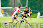 Dr Crokes Kieran O'Leary takes on the Rathmore's defence during their County Championship clash in Rathmore Sunday evening