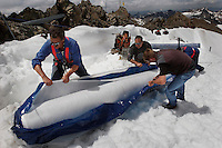 "Workers uncover rolls of the material and attached it to the top of the part of the glacier.  Brunnenkogel Ferner (Austrian word for glacier) is wrapped with a fleece-like cover to keep it from melting.  Covered ice melts slower. <br /> The ski area at 3,400 meters is covered to help save the ski industry since the glacier is retreating.  The cost of materials is one Euro per square meter.<br /> <br /> The Alpine glaciers -- in Austria, Switzerland, France and Italy -- are losing one percent of their mass every year and, even supposing no acceleration in that rate, will have all but disappeared by the end of the century. More hot, dry summers like that of 2003 in Europe, when the loss speeded to five percent, could cut the life expectancy to no more than 50 years, according to Wilfried Haeberli of the University of Zurich...""We estimate that by the end of the 21st century, with a medium-type climate scenario, about five percent of what existed in the 1970s will have survived, he added."