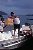 Altamira, Para State, Brazil. Prince Bernhard Foundation boat; men unloading.
