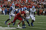 Miles Simpson tackles a University of Louisville player on Sunday, Sept. 2, 2012 in Papa John's Stadium in Louisville, Ky. Photo by Latara Appleby | Staff