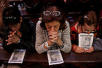 Woman pray as they celebrate their new Pope Francis at the Metropolitan Cathedral in Buenos Aires March 17, 2013. Photo by Juan Gabriel Lopera / VIEWpress.