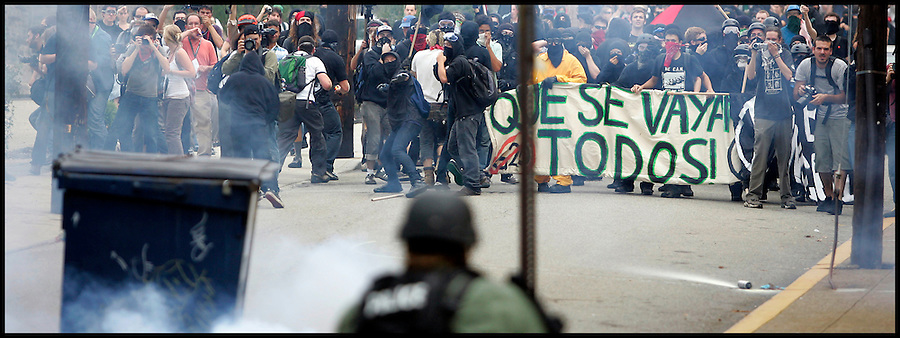 Sept. 24,  - Pittsburgh, Pennsylvania, USA - .Police fire tear gas at protesters and self-proclamed anarchist as they  attempt march toward downtown Pittsburgh, PA Thursday to the site of the G-20 Summit.  The group was eventually met with tear gas and sound cannon from riot police. Brian Blanco/ZUMA Press