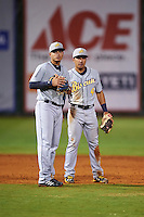 Montgomery Biscuits shortstop Willy Adames (12) and second baseman Kean Wong (4) during a game against the Chattanooga Lookouts on May 2, 2016 at AT&T Field in Chattanooga, Tennessee.  Chattanooga defeated Montgomery 9-6.  (Mike Janes/Four Seam Images)