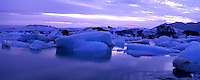 Jokulsarlon glacier lagoon is one of Icelands most spectacular sights, located about 60 km east of Skaftafell National Park and almost 400 km from Reykjavik. Jokulsarlon borders south and east part Iceland, at the roots of Europe's largest glacier Vatnajokull.  Breidamerkurjokull, an outlet glacier of the great glacier Vatnajokull, crumbles down the steep mountainside of the glacier and big icebergs break off into the lagoon where they float around before melting. This is a very popular sightseeing attraction, widely regarded as the most picturesque scenery in all of south Iceland. Series where taken in late June right after midnight when it's daylight 24 hours.