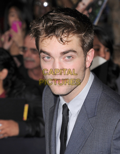 Robert Pattinson  .The Los Angeles premiere of 'The Twilight Saga Breaking Dawn Part 1' at Nokia Theatre at L.A. Live in Los Angeles, California, USA..November 14th, 2011.headshot portrait stubble facial hair rob grey gray suit black tie white shirt.CAP/RKE/DVS.©DVS/RockinExposures/Capital Pictures.
