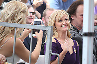 HOLLYWOOD, CA - MAY 04: Kate Hudson takes a quick phone picture of Reese Witherspoon  at the ceremony honoring Goldie Hawn and Kurt Russell with a double star ceremony on The Hollywood Walk of Fame on May 4, 2017 in Hollywood, California. Credit: Faye Sadou/MediaPunch