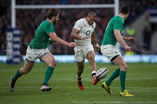 27.02.2016. Twickenham, London, England. RBS Six Nations Championships. England versus Ireland. England wing Anthony Watson kicks the ball past Ireland fly-half Jonathan Sexton.