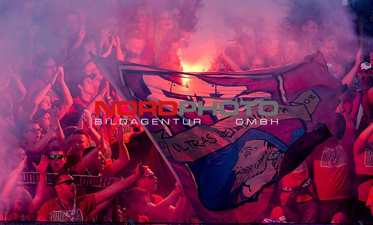 10.08.2019, Donaustadion, Ulm, GER, DFB Pokal, SSV Ulm 1846 Fussball vs 1. FC Heidenheim, <br /> DFL REGULATIONS PROHIBIT ANY USE OF PHOTOGRAPHS AS IMAGE SEQUENCES AND/OR QUASI-VIDEO, <br /> im Bild Bengalos, Pyrotechnik im Heidenheimer Fanblock, Heidenheimer Ultras<br /> <br /> Foto © nordphoto / Hafner