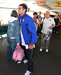 Nacho Novo gives a hug and a cuddle to Celtic fans as Rangers leave for Stuttgart and Celtic head for Tel Aviv at the same time at Glasgow airport