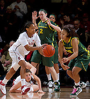 STANFORD, CA - February 26, 2011:  Melanie Murphy grabs a loose ball while Sarah James looks on in Stanford's 99-60 victory over Oregon at Stanford, California on February 26, 2011.