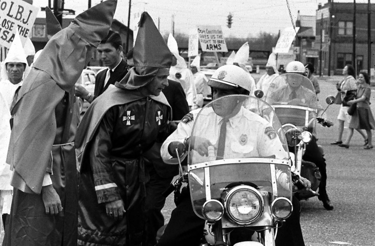 Ku Klux Klan parade along Dexter Ave. in Montgomery, Ala in December, 1967 to protest Dr. Martin Luther King Jr speaking at Dexter Ave. Baptist Church on Anniversary of Montgomery Bus Boycott. (Photo by Jim Peppler published in The Southern Courier Dec. 16, 1967). Copyright Jim Peppler/1967. This and over 10,000 other images are part of the Jim Peppler Collection at The Alabama Department of Archives and History:  http://digital.archives.alabama.gov/cdm4/peppler.php