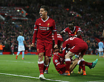 Roberto Firmino of Liverpool celebrates following the first goal by Mohamed Salah of Liverpool is acclaimed by his team mates during the Champions League Quarter Final 1st Leg, match at Anfield Stadium, Liverpool. Picture date: 4th April 2018. Picture credit should read: Simon Bellis/Sportimage