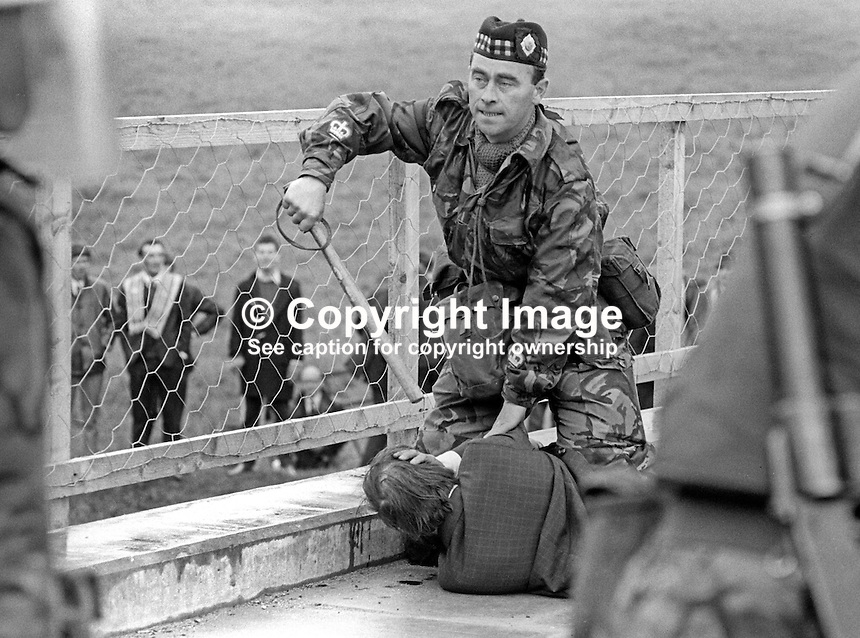 A British soldier restrains an Orange Order parade ban protester. It happened during a big police and army presence to enforce a Government ban on members of Orange Order parading through the predominently republican town of Dungiven, Co Londonderry, on Sunday 13th June 1971.   If the parade had proceeded it would almost certainly have led to serious clashes. 19710613220c<br />