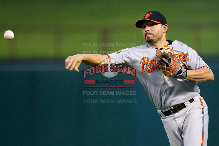 Baltimore Orioles second baseman Omar Quintanilla #35 throws to first during the Major League Baseball game against the Texas Rangers on August 21st, 2012 at the Rangers Ballpark in Arlington, Texas. The Orioles defeated the Rangers 5-3. (Andrew Woolley/Four Seam Images).