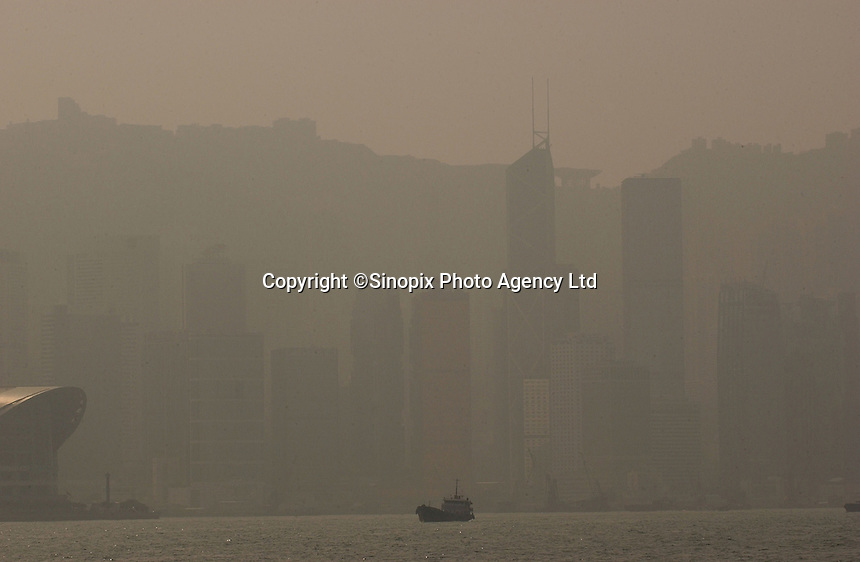 "Pollution, smog and haze hangs over Hong Kong's Victoria harbour at 2.00pm in the afternoon on a ""sunny and clear"" day in Hong Kong. Pollution in Hong Kong has been steadily increasing along with the industrialization of China. Clear views from the Hong Kong Peak, a major tourist destination are rare and pollution is now cited as a major reason for people leaving Hong Kong..18-JAN-05"
