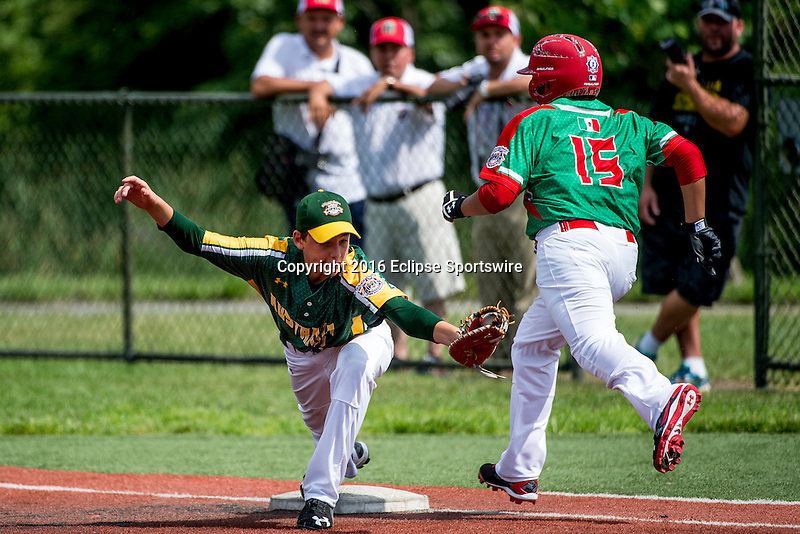 ABERDEEN, MD - AUGUST 02: Parker Robinson #21 of Australia makes the catch at first base to force out Erick Ortega #15 of Mexico in a game between Australia and Mexico during the Cal Ripken World Series at The Ripken Experience Powered by Under Armour on August 2, 2016 in Aberdeen, Maryland. (Photo by Ripken Baseball/Eclipse Sportswire/Getty Images)